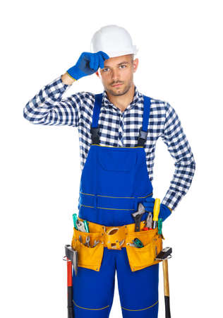 master: Friendly smiling construction worker saluting isolated on white background
