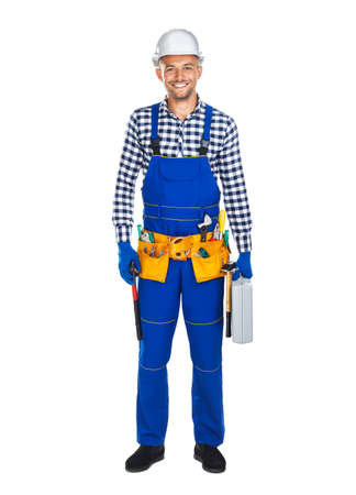 master: Full length portrait of smiling construction worker in uniform with toolbox isolated on white background Stock Photo