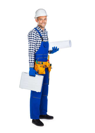 Side view of happy construction worker in uniform with toolbox and drawings isolated on white background. Full lenght portrait Stock Photo