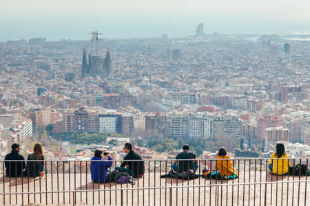 BARCELONA, SPAIN - JANUAR 24, 2017: People watching panorama view of Barcelona on a Bunkers del Carmel on weekends Editorial