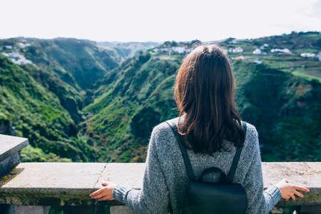 Back view of traveler woman enjoying beautiful green canyon on Gran Canaria, Canary islands, Spain. Tourism concept Stock Photo
