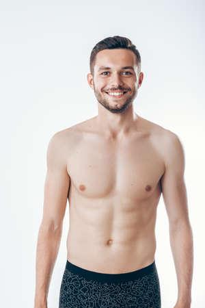 Portrait of handsome shirtless man. Man's torso