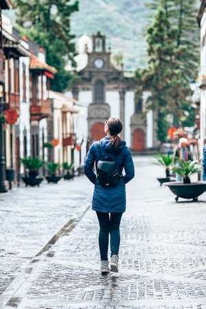 Female tourist enjoy small beautiful spanish town Teror, Gran Canaria, Canary Islands, Spain. Travel concept Reklamní fotografie