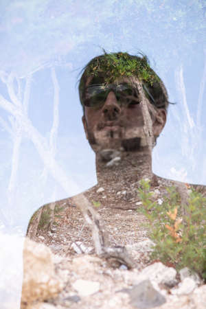 Double exposure of handsome man and nature background Imagens