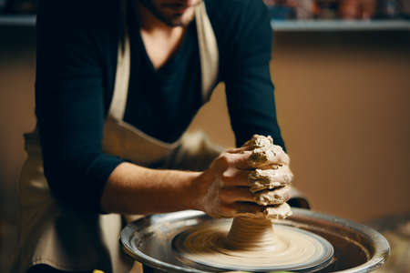 Modeling of clay on a potter's wheel in the pottery workshop. Art concept Foto de archivo