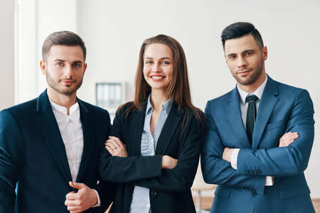 Group of successful smiling business people with with crossed arms in office Imagens