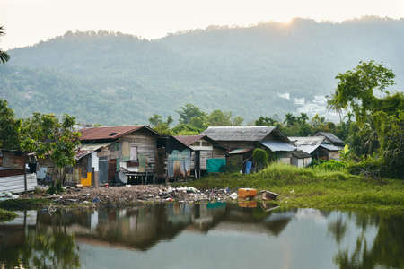 Slum houses on the river in Thailand