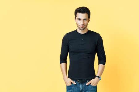 Handsome confident man on yellow background 写真素材
