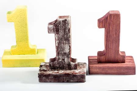 three digits one of wood Stock Photo