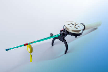 winter fishing rod on white background Stock Photo