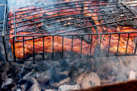 Grilled pork steaks on the grill