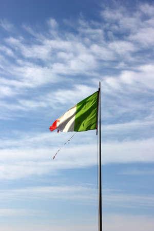 Rotten italian flag on corona empty beach in forte dei marmi, tuscany, italy