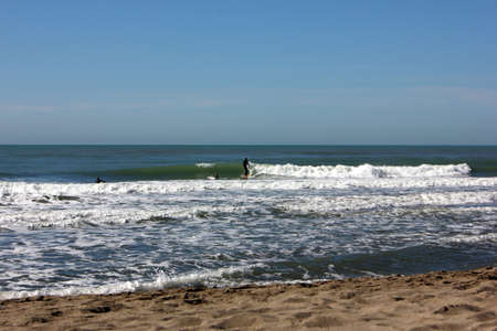 Surfing in corona times at Forte dei Marmi, Tuscany, Italy
