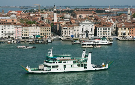 Panorama of Venice with a ferry boat in the foreground photo