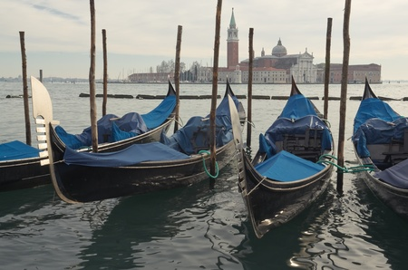 Gondolas in Venice, opposite the island of San Giorgio in winter Stock Photo - 12372339