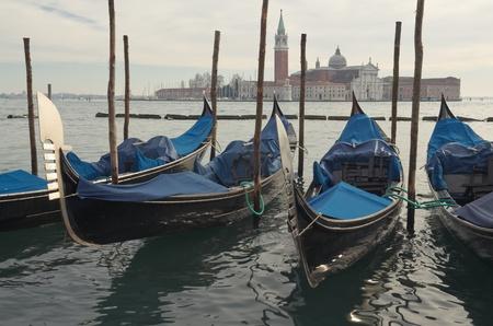 Gondolas in Venice, opposite the island of San Giorgio in winter photo
