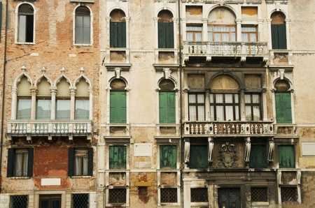 The facades of Venetian houses with balconies and windows photo