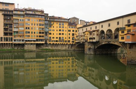 The bridge Ponte Vecchio in Florence and its reflection photo