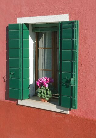 Window of a house from the island of Burano in Italy near Venice photo