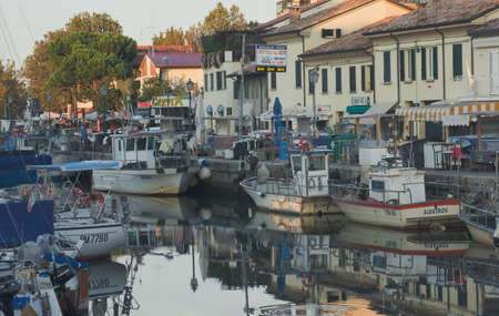 Fishermen's port in the rays of the setting sun. Cervia, Italy. Stock Photo - 17403189