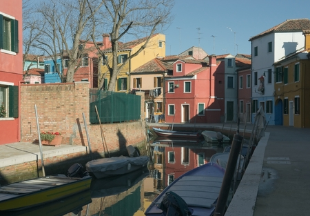Colorful houses on the island of Burano near Venice photo