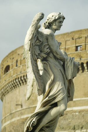The statue of an angel from the bridge SantAngelo in Rome Stock Photo