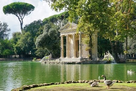 The temple of Aesculapius on the lake at the Villa Borghese in Rome Stock Photo