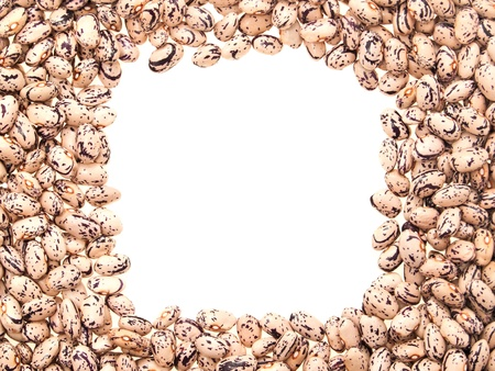 Mottled beans, laid out in the form of a frame. On a white background. photo
