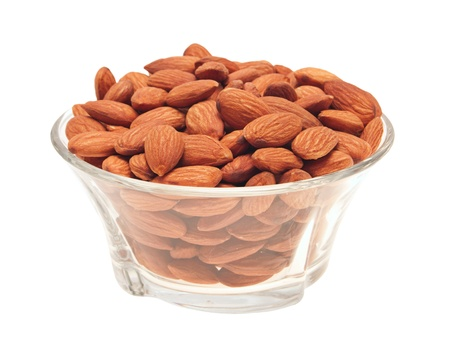 Peeled almonds in a glass bowl  Isolated on white Stock Photo - 13752395