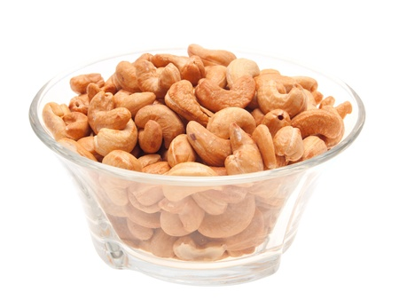 Cashew nuts in a glass bowl. Isolated on white. Stock Photo - 13767939