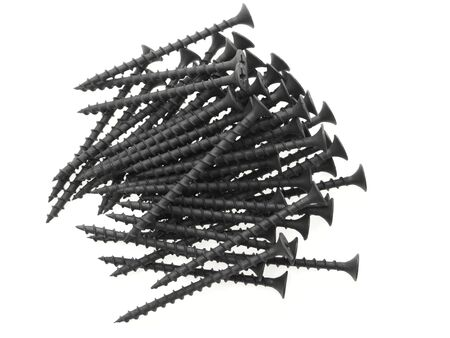 A pile of black screws. Isolated on white. photo