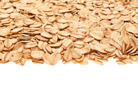 Oatmeal, laid out a straight line. On a white background. photo