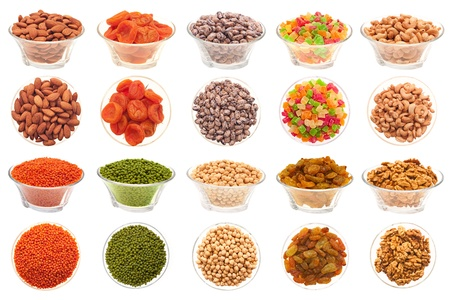 A set of pictures of nuts, legumes and dried fruit in a glass bowl on a white background  photo