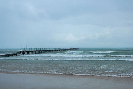 sea wooden pier on a rainy day