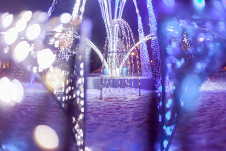 Winter LED lantern, in the foreground blurred LEDs Stock Photo