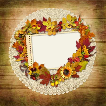 mammy: Stamp-frame with autumn leaves on a wooden background