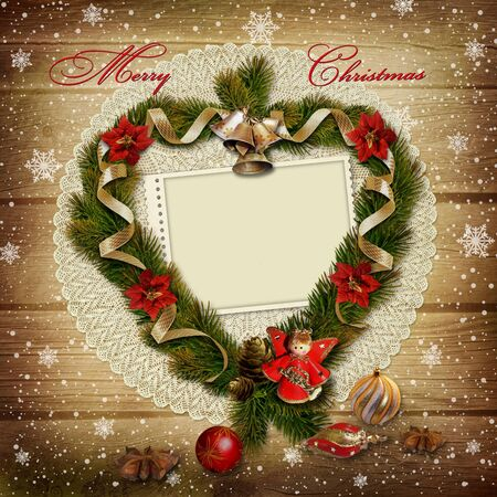 Card with wreath of pine branches on snowy wooden background  photo
