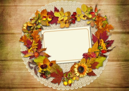 mammy: Wreath of autumn leaves with place for text or photo on a wooden background  Stock Photo