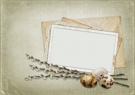 Old frame with willow and eggs on the vintage background  photo