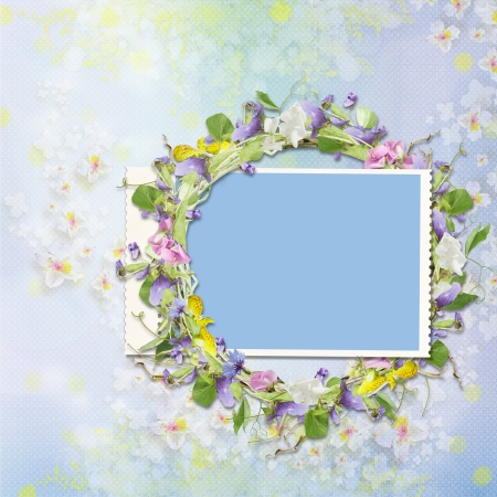 Frame with a wreath of flowers on a beautiful background photo