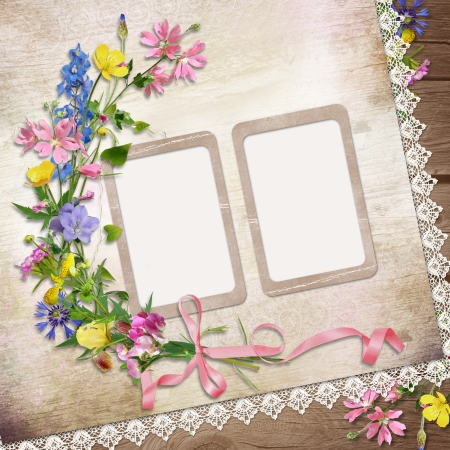Flowers and frame on vintage background photo