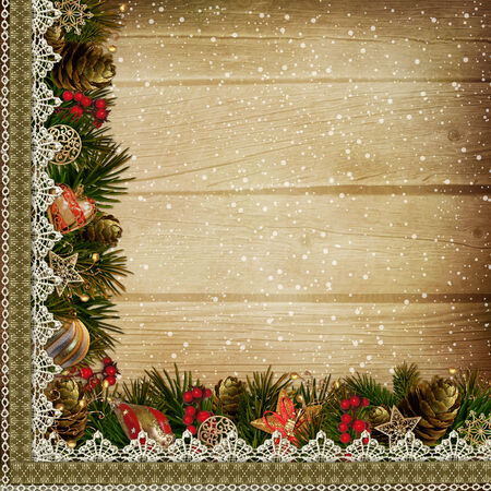 Border with Christmas decorations on wooden background photo