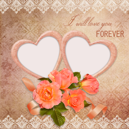 The frame in the form of heart with roses on vintage background photo