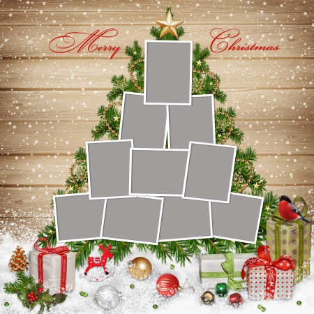 hristmas: Frames for family, Christmas decorations and gifts on wooden background Stock Photo