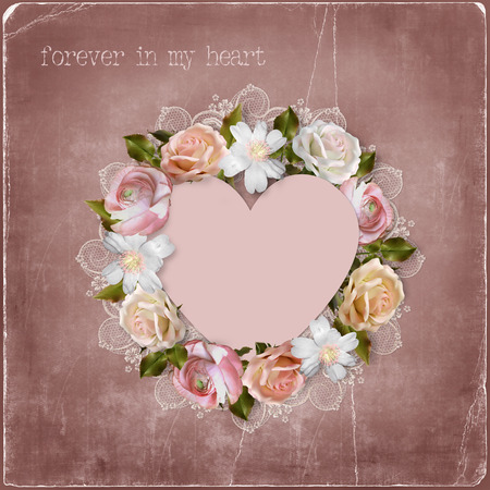 Wreath of flowers and heart on vintage background  photo