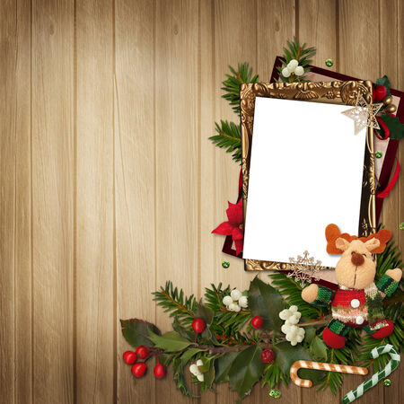 Frame with gorgeous Christmas decorations on wooden background photo
