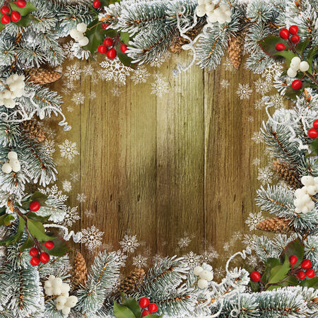 pine cones: Christmas greeting background with pine branches and berries Stock Photo
