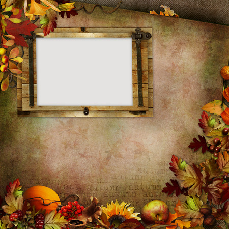 album: Autumn leaves, berries, vegetables and frame on a green vintage background