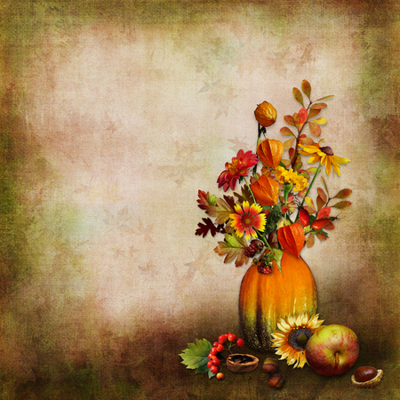 Vintage background with autumn leaves, berries in a vase from pumpkin