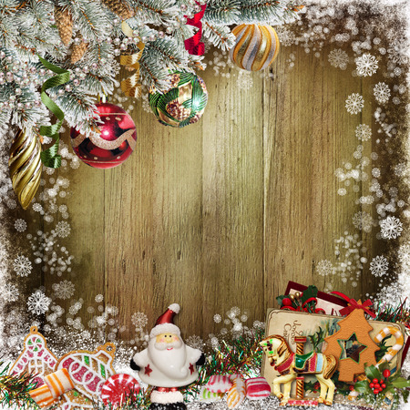 paper old: Christmas congratulatory background with pine branches, candy, Santa Claus and Christmas decorations